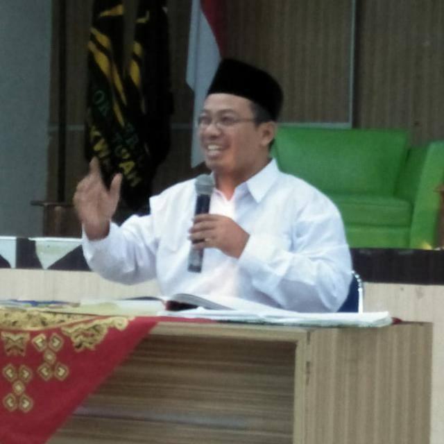 Dr. Fauzi, M.Ag